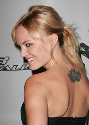 "Malin has a lotus flower with Tibetan sanskrit meaning ""to play"" on her upper back."