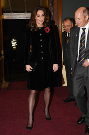 Kate Middleton went for understated elegance in a black velvet coat by Catherine Walker at the Royal Festival of Remembrance.