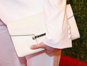 Christina Hendricks kept it all white with a leather envelope clutch at the 5th Annual Veuve Clicquot Polo Classic.