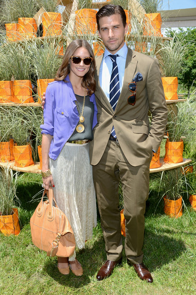 Johannes Huebl stuck to his classic preppy style when he sported a two-button tan suit with a sophisticated blue and white striped tie.