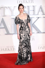 Dakota Johnson looked absolutely enchanting in an embroidered black-and-white gown by Alexander McQueen at the UK premiere of 'Fifty Shades Darker.'