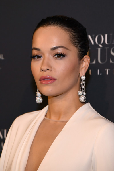 Rita Ora slicked her hair back into a twisted bun for the Paris premiere of 'Fifty Shades Freed.'