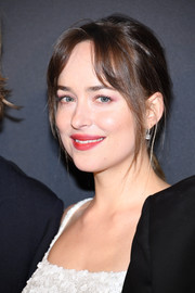 Dakota Johnson opted for a casual ponytail when she attended the Paris premiere of 'Fifty Shades Freed.'