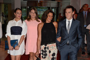 Pauline Ducruet teamed her frock with a zip-embellished leather clutch.