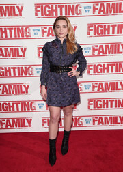 Florence Pugh gave her cute frock a dose of edge with a pair of black mid-calf boots.