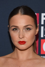 Camilla Luddington sported a sleek center-parted ponytail at the Great British Film Reception.