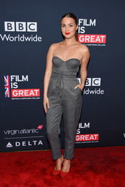 Camilla Luddington was all about relaxed sophistication in a strapless gray jumpsuit at the Great British Film Reception.