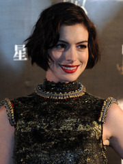 Anne Hathaway chose a rich red lip color for a bold pop to her look.