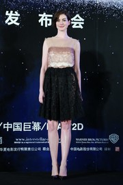 Anne Hathaway went the ultra-girly route in a nude and black Lanvin lace dress during the 'Interstellar' press conference in Shanghai.