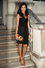 She looked very elegant in a little black dress with sheer panels which she teamed with mid-heel sandals and a bright coloured clutch. The clutch provided a nice pop of color against her black dress.