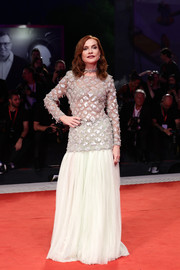Isabelle Huppert cut a glamorous figure in an embellished gray gown by Armani Prive at the 2019 Venice Film Festival.