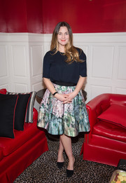 Drew Barrymore donned a simple navy silk blouse for the Financo CEO Forum.