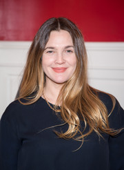 Drew Barrymore was hippie-chic at the Financo CEO Forum wearing this long center-parted 'do.