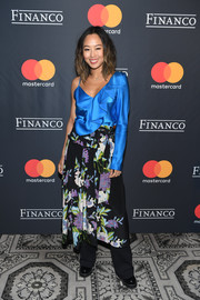 Aimee Song braved the cold New York weather in a one-sleeve blue ruffle top by Diane von Furstenberg during the Financo CEO Forum 2017.