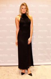 Alexandra Richards went for simple sophistication in a sleeveless black turtleneck dress by Christian Dior during the Fine Arts Museums of San Francisco Mid-Winter Gala.