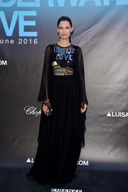 Bianca Balti donned a tiered black Colosseum-embellished, 'Italia is Love' gown by Dolce & Gabbana for the Underwater Love Party. Can't get more Italian than that!