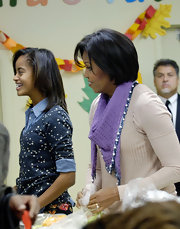 Michelle Obama's beaded lavender scarf was a chic complement to her sweater.