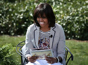 Michelle Obama wore a chic pinstripe blazer over a floral shirt during the White House Easter Egg Roll.