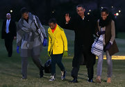 Returning from a Hawaiian vacation, Sasha Obama looked so sunshiny in a bright yellow pea coat.