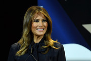 Melania Trump framed her beautiful face with a subtly wavy 'do for a Las Vegas Town Hall meeting.