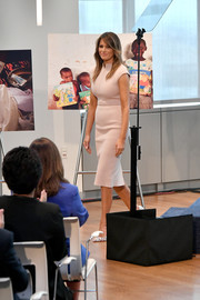 Melania Trump hosted a reception in honor of UN General Assembly attendees wearing a fitted blush midi dress by Scanlan Theodore.