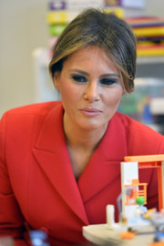 Melania Trump sported her signature smoky eye while visiting Necker Hospital in Paris.