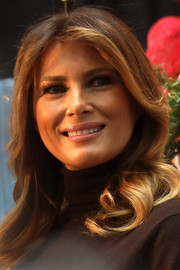 Melania Trump wore her hair in a long wavy style with a center part for her visit to Children's National Hospital.