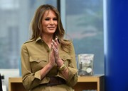 Melania Trump dolled up her utilitarian dress with some gold bracelets for her visit to the American International School in Riyadh.
