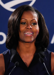 Michelle's side-parted strands looked ultra-sleek at a campaign rally in May 2012.