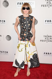 Anna Wintour looked delightful in a whimsical print dress by Prada at the world premiere of 'The First Monday in May.'