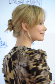Olivia Wilde arrived at the premiere of 'The Five Year Engagement' wearing her lightened tresses in a casual bun with long wispy bangs.