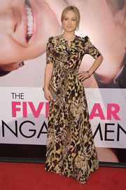 Olivia Wilde accessorized her pattered dress with gold squiggle and hammered bangles.