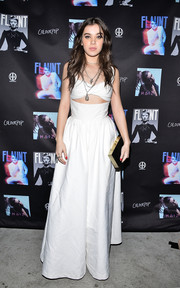 Hailee Steinfeld looked sassy in a white Rosie Assoulin jumpsuit with a midriff cutout and super-flared legs while celebrating her EP 'HAIZ.'