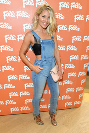 Mollie King made denim overalls look oh-so-hot when she wore this Rebecca Minkoff number over a black lace crop-top at the Folli Follie flagship store opening.