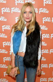 Laura Whitmore jazzed up her outfit with a two-tone fur scarf for the new Folli Follie flagship store launch.
