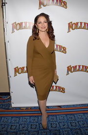 Gloria Estefan looked marvelous in a sexy brown wrap dress on the opening night of 'Follies.'