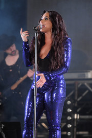 Demi Lovato accessorized with a huge cocktail ring for added sparkle to her sequined jumpsuit during her concert at Fontainebleau Miami Beach.