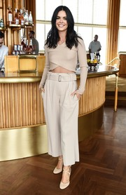 Nude cross-strap pumps finished off Katie Lee's monochromatic look.