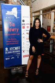 Tia Mowry styled her dress with chic black gladiator heels.