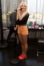 Pixie Lott added pop to her leggy look with hot pink leather brogues.