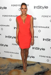 Dania Ramirez paired her coral figure-hugging frock with mocha-colored peep-toe pumps.
