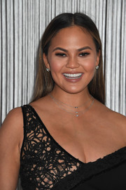 Chrissy Teigen attended the Forevermark Tribute event wearing a simple straight 'do.