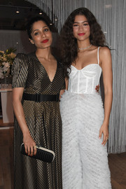Freida Pinto attended the Forevermark Tribute event carrying a black-and-white Bottega Veneta Knot clutch.