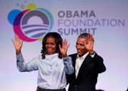 Michelle Obama kept it smart in a pale blue cowl-neck shirt at the Obama Foundation Summit.