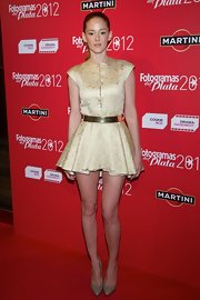 Ana Maria Polvorosa opted for a modern look with this gold brocade dress with metallic belt.