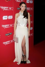 Ana Rujas opted for a white evening gown that showed a bit of skin with a side cutout and front slit.