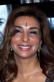Shimmering purple shadow brightened Shobna's lids at the premiere of 'Four' in London.