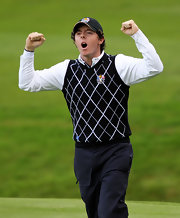 Rory hits the green in a black-and-white sweater vest.