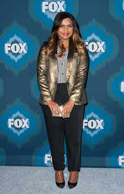 Mindy Kaling added extra shine via a metallic gold Kotur clutch.