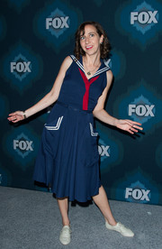 Kristen Schaal struck a comical pose at the Fox All-Star party wearing a navy nautical dress with white trim and a red tie.